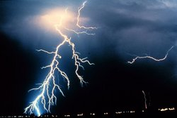 Multiple cloud-to-ground and cloud-to-cloud lightning strokes are observed during a night-time thunderstorm.