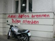 "May Day graffiti in Berlin. The text reads, "": Cars burning, cops dying"", a typical exaggeration."