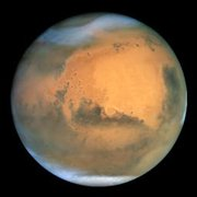 Mars, with polar ice caps visible.