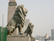 "Lions guard the Kasr-el-Nil Bridge which traverses the Nile at Tahrir Square. European architecture and urban design, major infrastructural projects and intense cultural patronage were part of  Ismail's vision for Cairo as ""Paris on the Nile."""